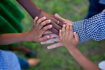 Interracial family hands